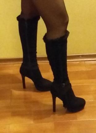 Женские сапоги на высоком каблуке mia may