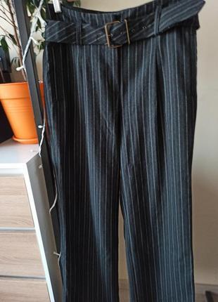 Широкие брюки с защипами складками высокая посадка