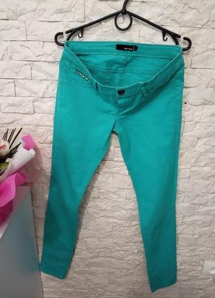 Бирюзовые джинсы