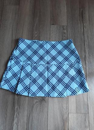 Голубая юбка в клетку