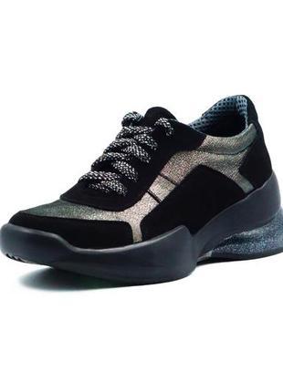 Черные кожаные кроссовки с серебристыми вставками