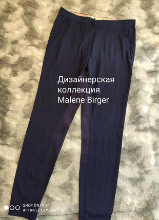 Дизайнерские стильные зауженные брюки темно-синего цвета