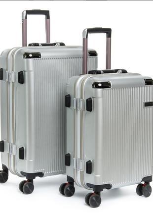 Abs пластикова дорожня валіза на 4-х колесах. (комплект).