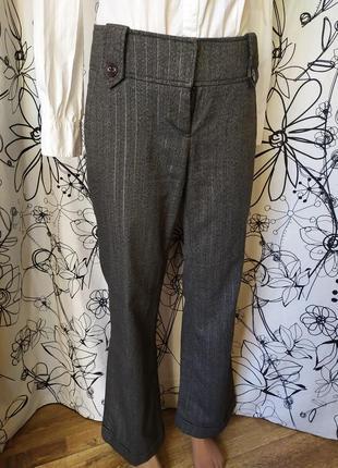 Классические брюки клеш в полоску серебристую