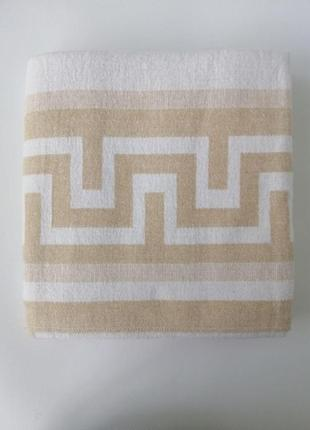 Хлопковое плед-одеяло бежевого цвета со сложным жаккардовым переплетением