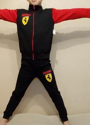 Продам детский костюм puma ferrari.размер 110-116.цвет черный.осталось 2 комплекта4 фото