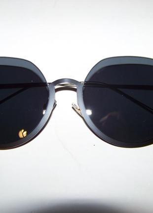 Полуободковые округлые солнцезащитные очки с черной дымчатой линзой2 фото