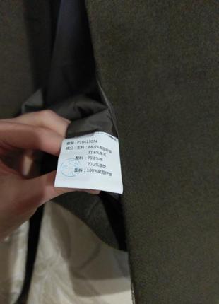 Оригинальное брендовое пальто прямого кроя с капюшоном и спущенным плечом9 фото