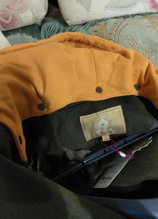 Оригинальное брендовое пальто прямого кроя с капюшоном и спущенным плечом6 фото