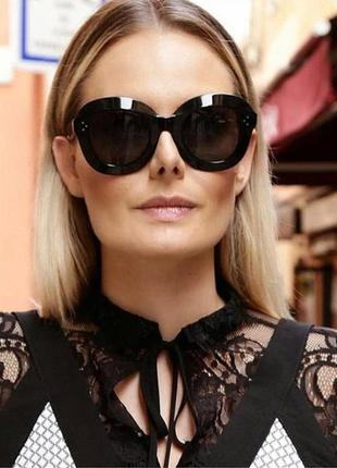 Стильные черные округлые очки с дымчатой серой линзой и глянцевой оригинальной оправой