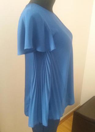 Нежная блузка с плиссеровкой