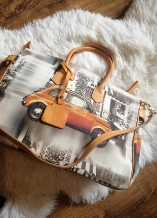 Кожаная сумка с машиною