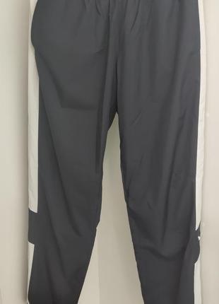 Синие спортивные штаны puma с белыми полосами по бокам (оригинал)