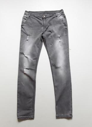 Серые джинсы скини рваные