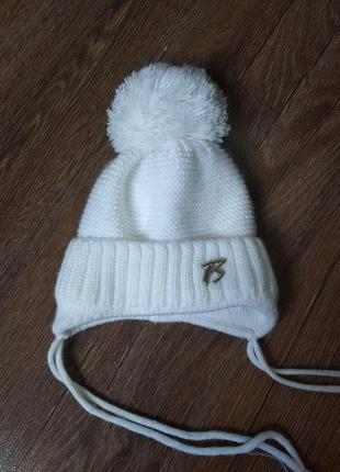 Теплая шапка для девочки с 2 до 6 месяцев