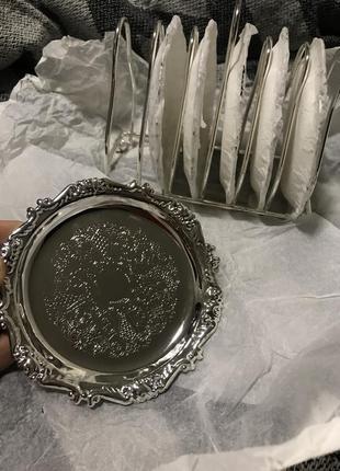 Набор серебряных тарелок