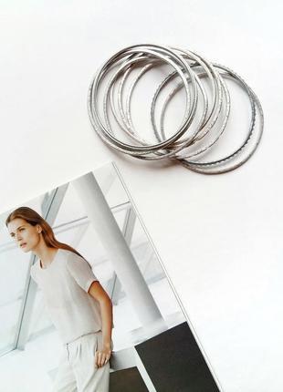 Набор из девяти серебристых браслетов accessorize