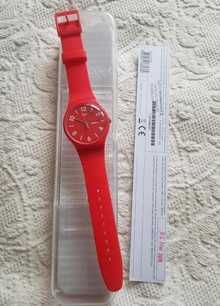 Швейцарские часы swatch алого цвета5 фото