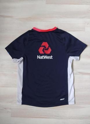 Детская синяя спортивная футболка new balance xs82 фото
