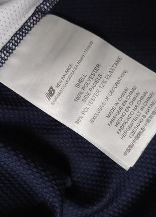 Детская синяя спортивная футболка new balance xs86 фото