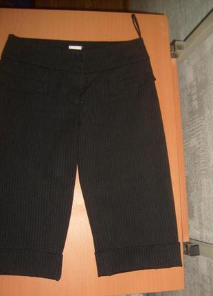 Удлиненные шорты до колен