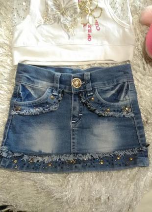 Стильная джинсовая миниюбка для маленькой модницы.
