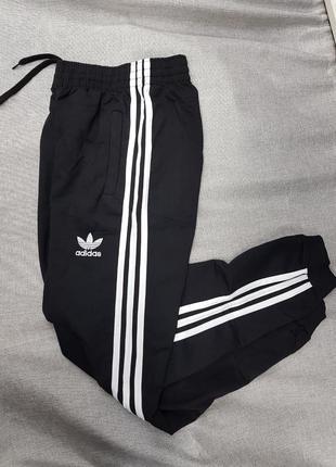 Штаны adidas спортивные брюки женские трикотаж зауженные на манжете чёрные штаны  унисекс