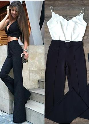 Стильные, черные клешные брюки
