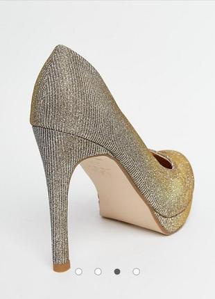 Сияющие нарядные туфельки на платформе и высоком каблуке2 фото