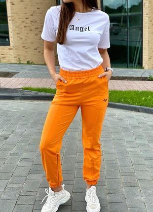 Спортивный костюм футболка и штаны на манжетах1 фото