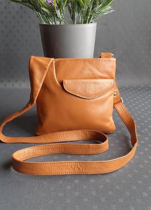 Кожаная красивая сумка кроссбоди фирмы taurus