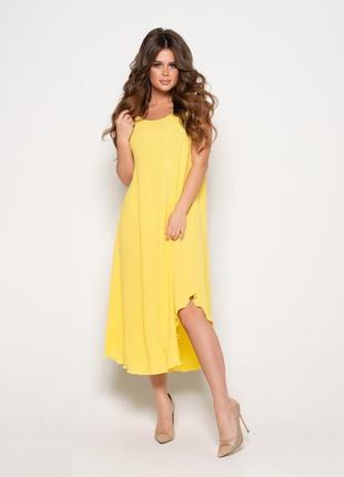 Желтый расклешенный сарафан с карманами