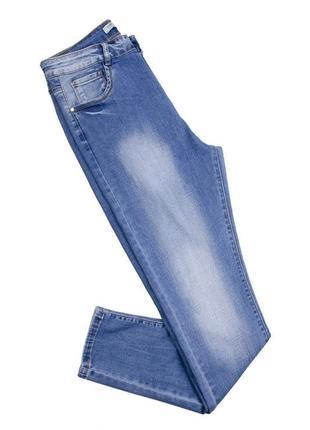 Женские синие джинсы1 фото