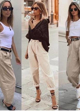Zara  тренд сезона брюки с защипами бананы