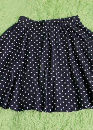 Темно-синяя в горошек трикотажная юбка-клеш