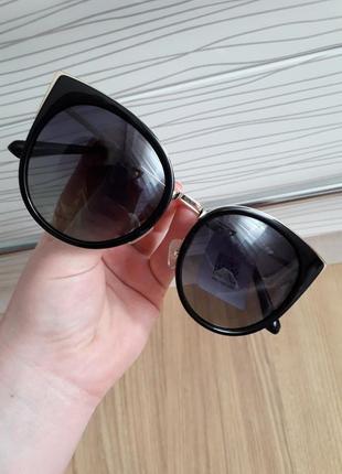 Солнцезащитние очки