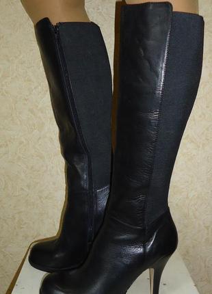 Продам женские кожаные сапоги next