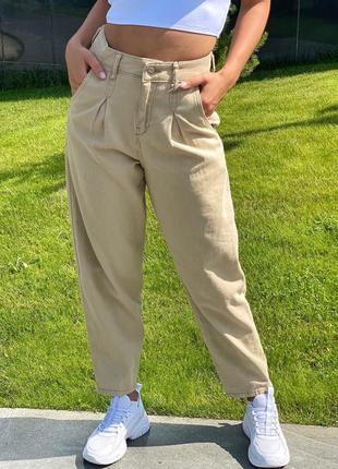 Женские джинсы с защипами