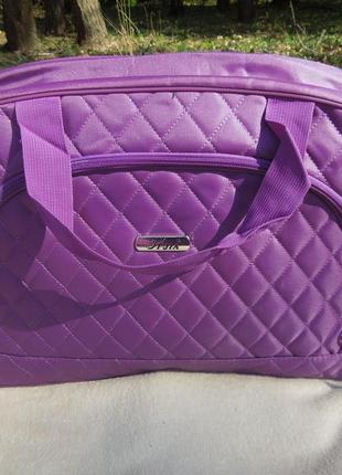 Дорожня сумка фіолетова