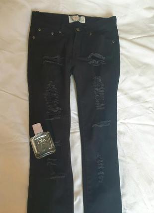 Рваные джинсы-скинни с высокой посадкой2 фото