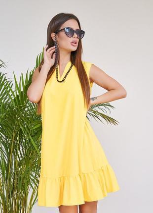 Желтое расклешенное платье с воланом