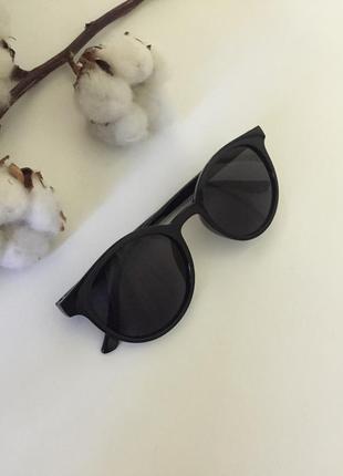 Солнцезащитные очки чёрного цвета круглые чёрные солнцезащитные очки