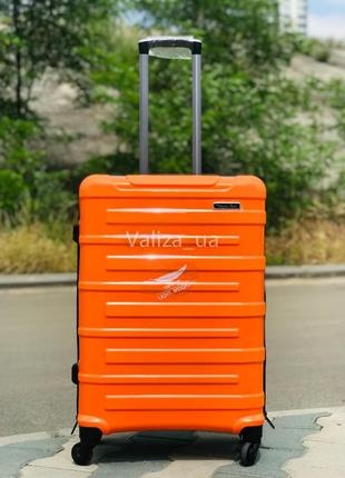 Качество! чемодан из полипропилена пластиковый средний оранжевый валіза середня