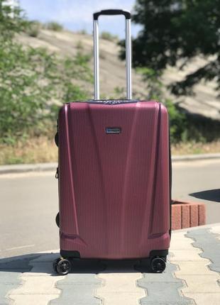Большой чемодан из поликарбоната бордовый франция