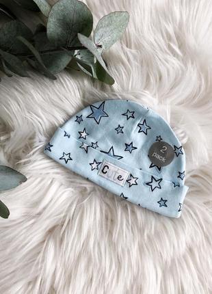 Детская голубая шапочка в звездочки
