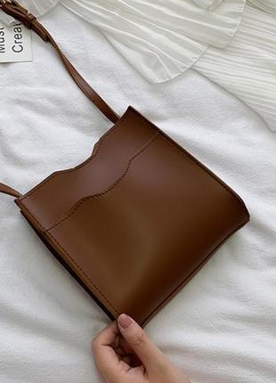 Коричнева сумочка