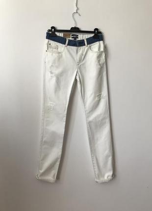 Білі джинси kiabi
