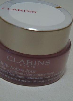 Clarins дневной гель от возрастных изменений с антиоксидантом. есть подарки