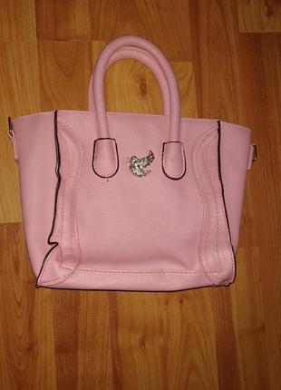 Красивая розовая сумочка с короткими ручками