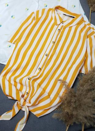 Блуза рубашка в помаранчеву полоску з актуальними гудзиками під дерево